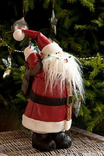 leather look red santa with teddy bear sack by the orchard