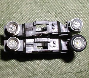 Original Aurora AFX Stocker Wheel Magnatraction Chassis Parts Lot