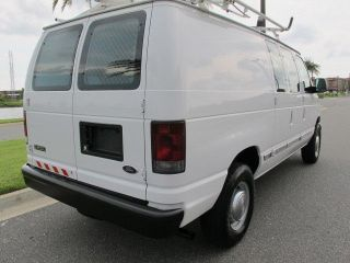Ford E250 Cargo Van with Bins Shelves AC Power Inverter and Ladder Racks