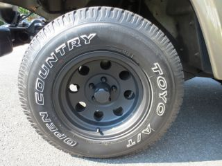 "Jeep 15x7 American Racing Baja Wheels with 30"" Toyo A T Tires"